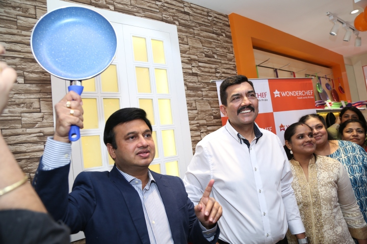 Ravi Saxena MD Womderchef and Chef Sanjeev Kapoor displays the product at commercail street store.JPG